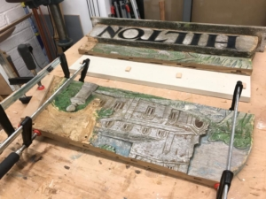The village sign in pieces