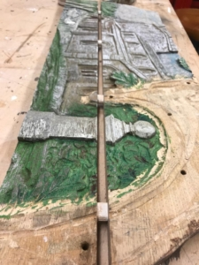 Sections of the village sign being restored