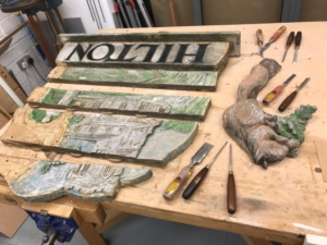 The village sign ready to be reeassembled