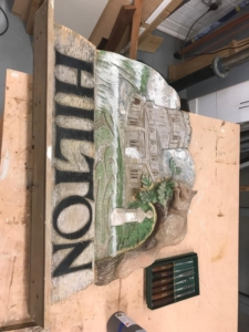 The reassembled village sign ready to be painted